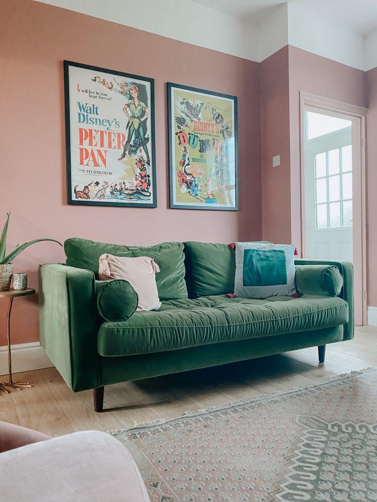 vintage disney prints in pink and green living room