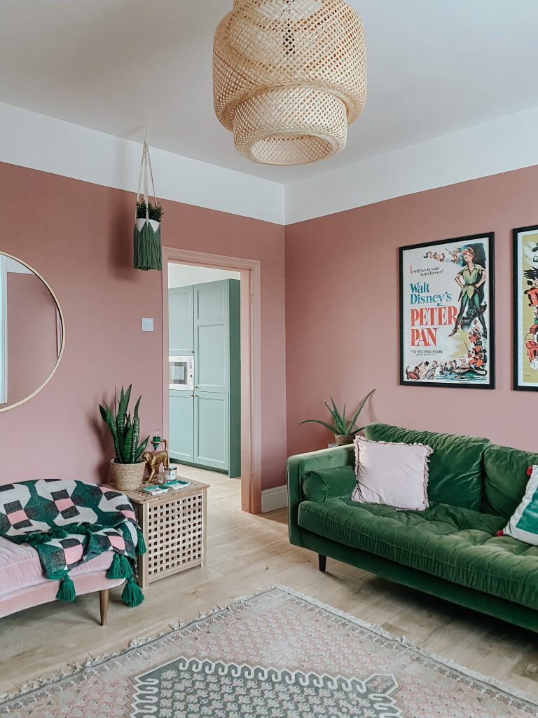 pink living room with green sofa
